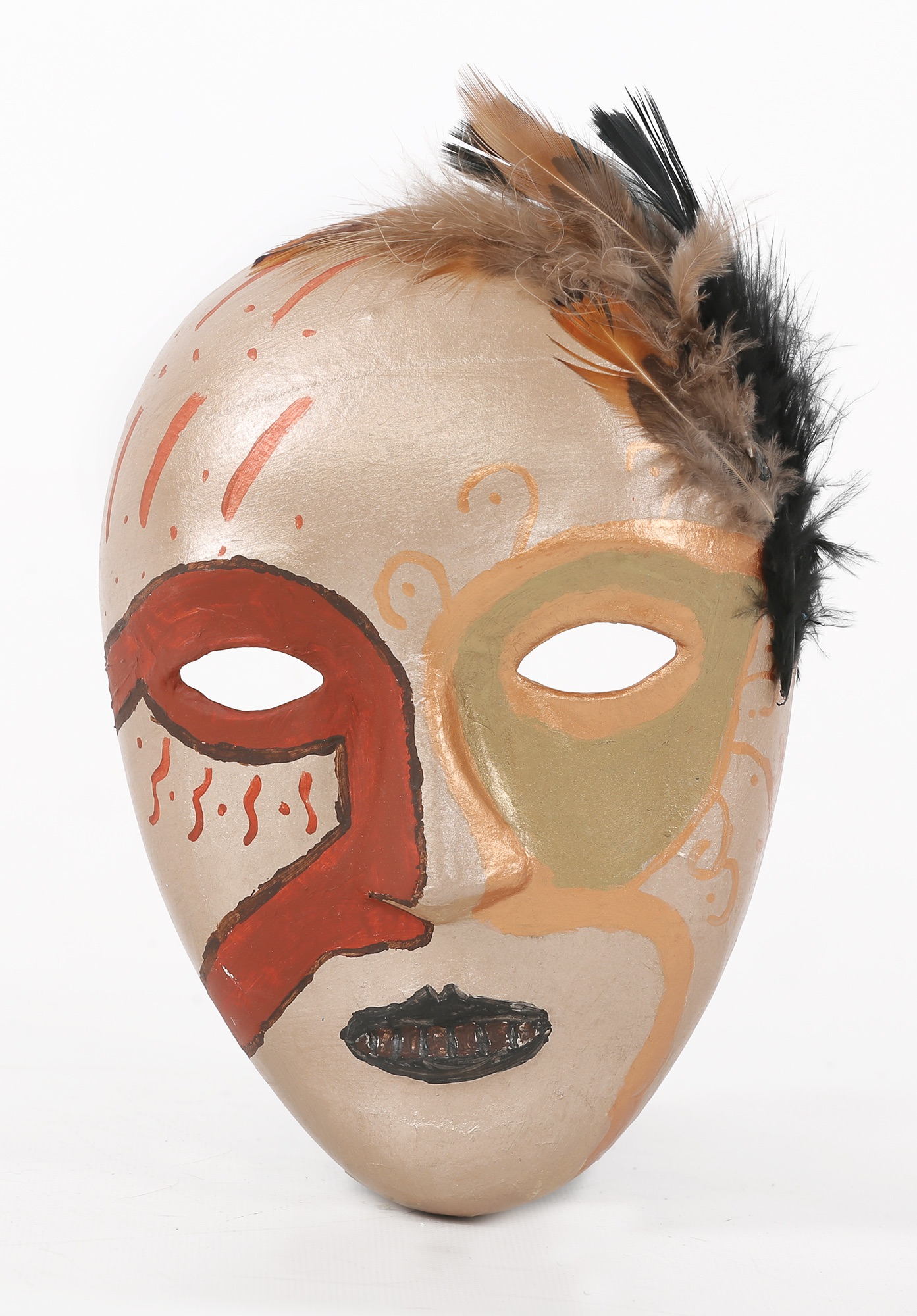 A mask painted in gold, with a traditional opera mask ringing the eyes in scarlet and bronze, and feathers attached to the top left side of the forehead.